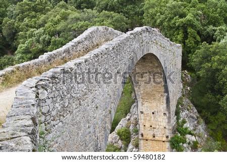 XII century medieval bridge, in Tortella, Catalonia - stock photo