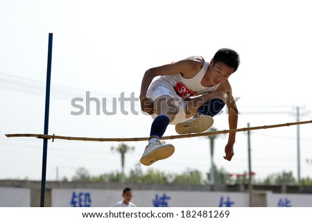 Xingtai City, China - May 12: In May 12, 2011, baixiang County Middle School Games were held. Unidentified student athletes in the high jump worked hard to win the game.  - stock photo