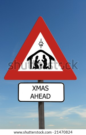 Xmas Ahead warning roadsign over blue sky
