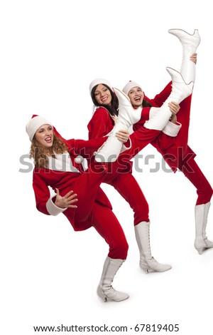 Xmas background: three girls in santa costumes playing on teir legs like on guitars,  isolated on white - stock photo