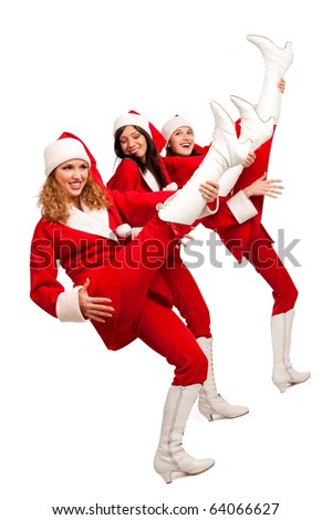 Xmas background: three girls in santa costumes playing on their legs like on guitars,  isolated on white - stock photo