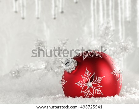 xmas ball decoration on snow and frost glasses wall