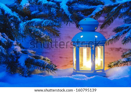 xmas candle light lantern in snow - stock photo
