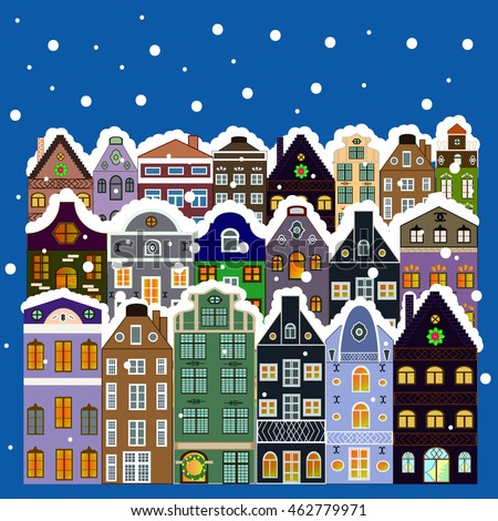 Xmas card with a decorated snowy old town at Christmas eve