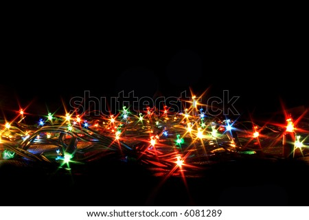 xmas color ligts on the black background - stock photo