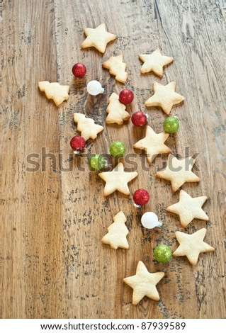 Xmas cookies and coloured balls - stock photo