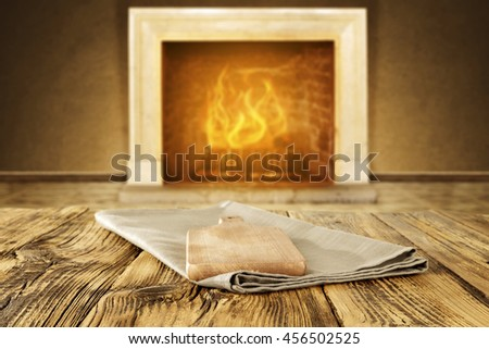 xmas fireplace and wooden table place  - stock photo