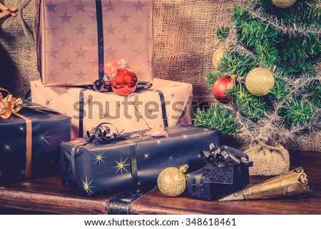 Xmas gifts under the tree in vintage colors - stock photo