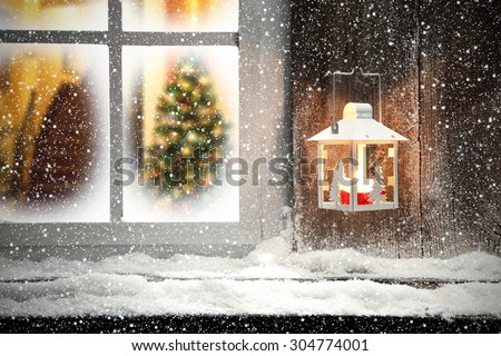 xmas lamp and window sill of cold snow  - stock photo