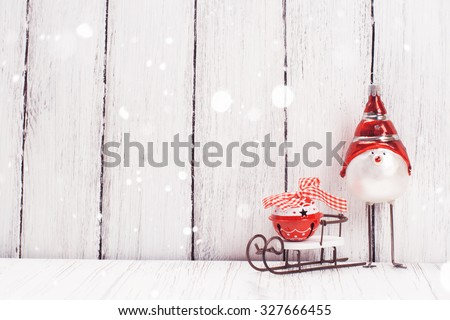 Xmas or new year composition with sledge, little bell and funny bird on white wooden background. Xmas card. Space for text. Selective focus - stock photo