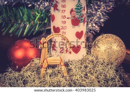 Xmas ornament with a candle and shiny baubles - stock photo