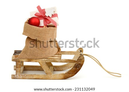 Xmas present in santa bag - stock photo