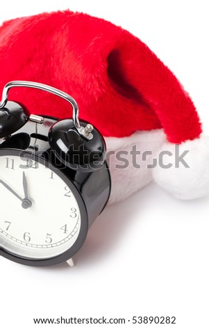 xmas red hat and alarm clock on white background - stock photo