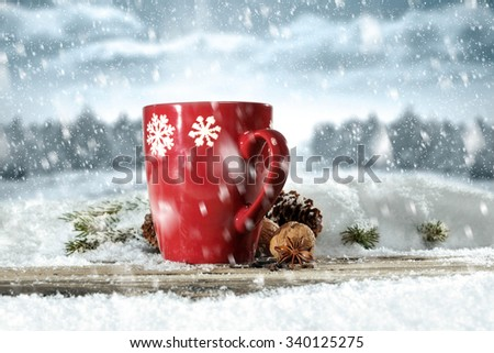 xmas red mug cone and wooden desk top of snow