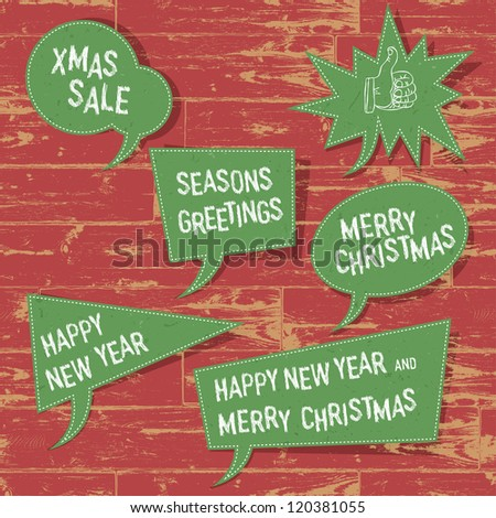 Xmas speech bubbles on wooden texture. Raster version, vector file available in portfolio. - stock photo