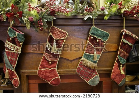 Xmas Stockings on a mantle - stock photo