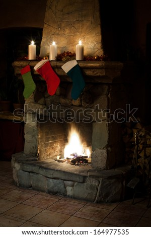 xmas stockings on fireplace background. Chimney place with fire. vintage interior