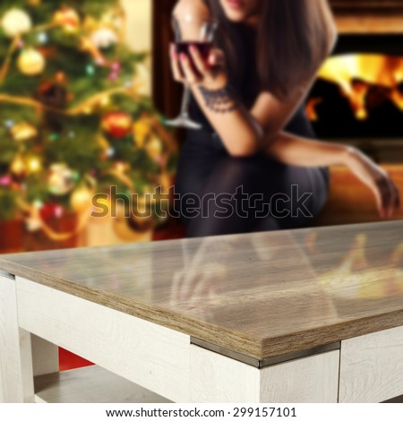 xmas tree fireplace and wooden table