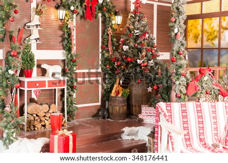 xmas vintage interior with tree, wood, boxes and toys - stock photo