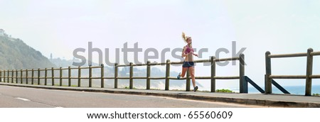XXXL image - happy fitness running girl outdoors at the beach. Lots of copyspace provided - stock photo