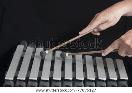 Xylophone with mallets and male hands playing
