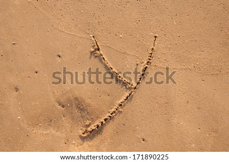 Y text written in the sandy on the beach - stock photo