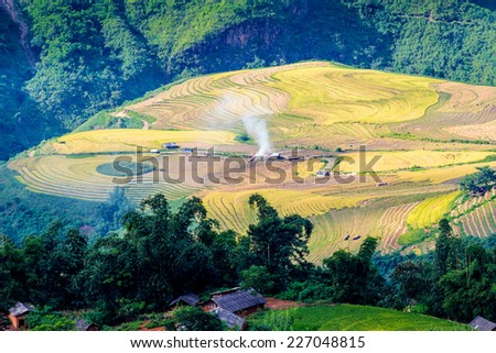 Y TY, LAOCAI, VIETNAM - SEPTEMBER 6, 2014 - Rice terraces on a hill. The ethnic people cut off top of the hill to create paddy fields. This process took place for several years. - stock photo