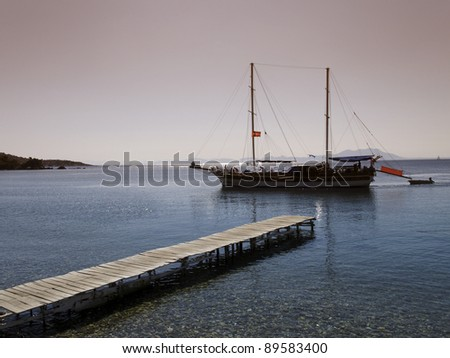 Yach at sea in the evening light - stock photo