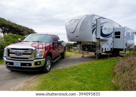 YACHATS, OR - MARCH 19, 2016: Campsite with a large Arctic Fox 5th Wheel and a Ford F350 truck. - stock photo