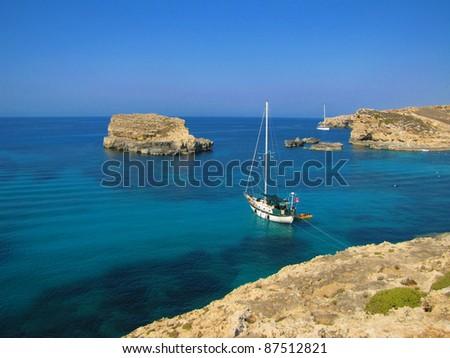 Yacht anchored in the Blue Lagoon in Comino (Malta) - stock photo