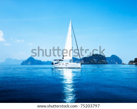 yacht and blue water ocean - stock photo