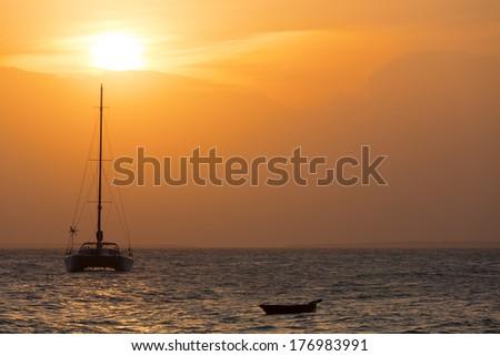 Yacht and boat during sunset, Zanzibar, Tanzania - stock photo