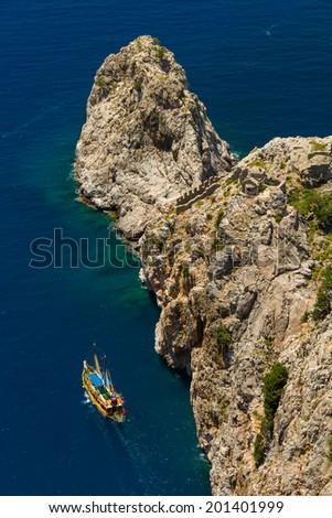 Yacht and boat in sea gulf near Alanya, Turkey. Mediterranean sea. - stock photo