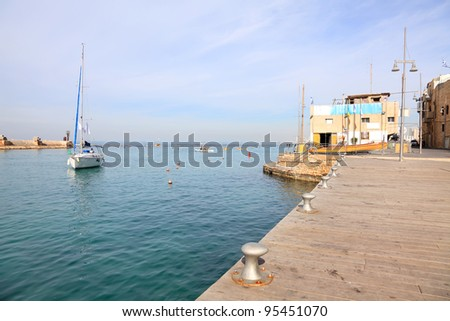 Yacht at a mooring in the Old Jafo port and beautiful quiet morning sea landscape. Israel - stock photo