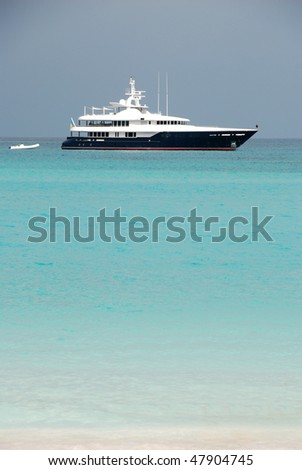 Yacht at anchor in Bay St Jean on the island of St Barts, French West Indies - stock photo