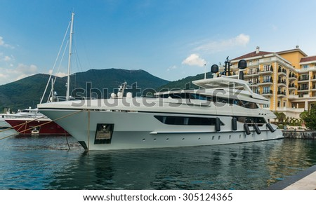 Yacht at Luxury Waterfront Mansion in Porto Montenegro. - stock photo
