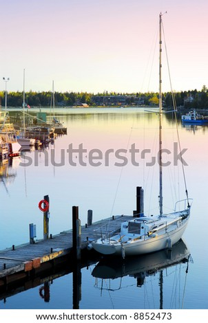 Yacht at the wooden dock in early morning in Tobermory Ontario Canada - stock photo