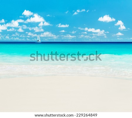 Yacht at tropical ocean beach. Anse Georgette, Praslin island, Seychelles - vacation background - stock photo