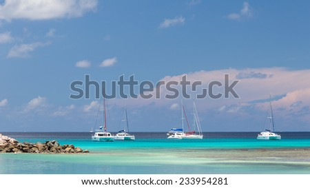 Yacht clear turquoise waters of the Indian Ocean off the coast of Seychelles