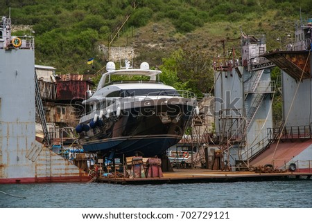Yacht for repairs in a floating dock in the bay of Sevastopol. Crimea, Ukraine. May, 2009