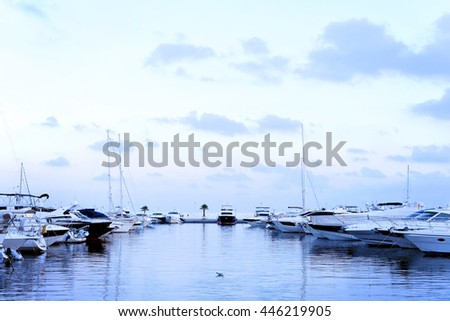 Yacht harbor after sunset at blue hour. - stock photo