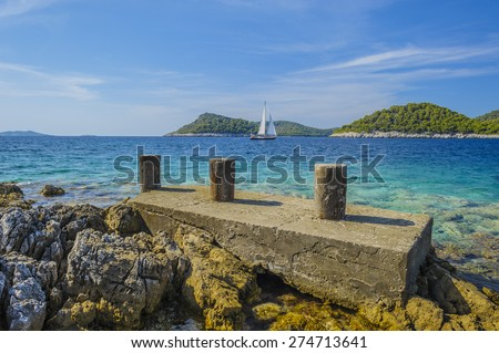 Yacht in archipelago, Lastovo, Croatia. - stock photo