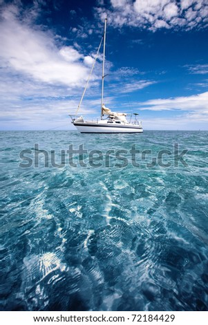 Yacht in beautiful tropical waters - stock photo