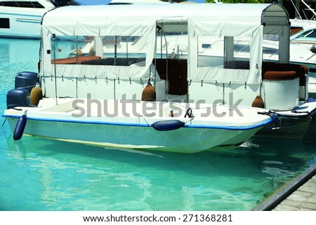 Yacht in marina in resort - stock photo