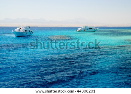 Yacht in sea with coral reefs