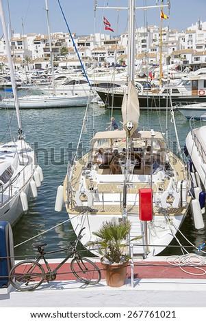 Yacht in summer Puerto Banus in Spanish resort - stock photo