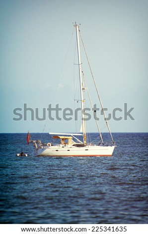 Yacht in the bay at anchor. - stock photo