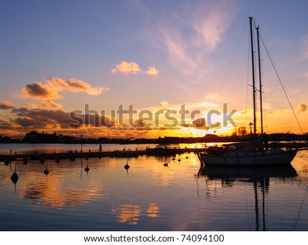 Yacht in the early evening. Sailboat On Sunset. Beautiful idyllic picture. - stock photo