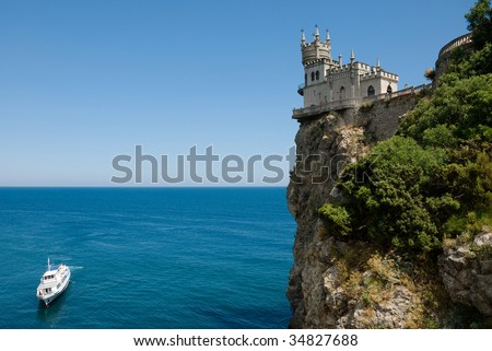 yacht in the sea and castle - stock photo