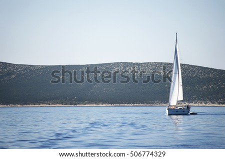 Yacht in the sea on a bright sunny day